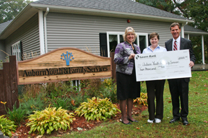 Savers Bank present donation to AYFS