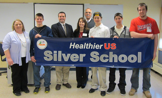 John Magnarelli, a senior official from the U.S. Department of Agriculture presents Valley Tech with the HealthierUS School Challenge Silver Award.